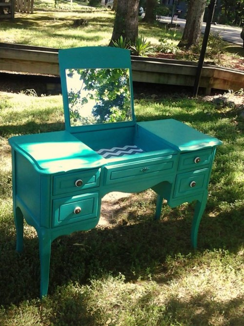 An oh-so pretty green dressing table.
